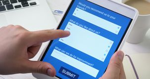 Taking online survey using smartphone digital tablet stock footage