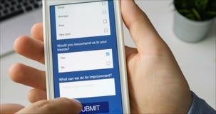 Taking online survey using smartphone stock video