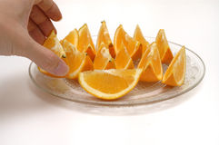 Taking orange slices. A hand taking the orange slices. isolated Stock Photo