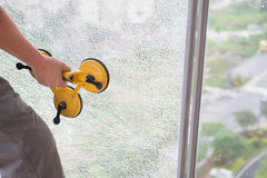 Taking out on a broken window. With suction plate Royalty Free Stock Photography