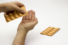 Taking out pill from blister Royalty Free Stock Photos