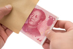 Taking out stack of RMB paper currency from envelope with clipping path Stock Photography