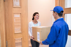 Taking parcel to the house Stock Photography