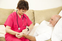 Taking Patient's Pulse Royalty Free Stock Photography