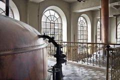 Taking a peek?. The kettle room from an old abandoned beer brewery Stock Photos