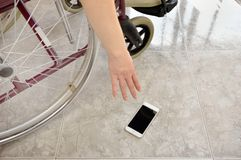Taking the phone off the floor royalty free stock image