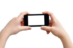 Taking photo. Boy is taking photo on mobile device, isolated on white, clipping path Royalty Free Stock Photo