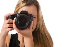 Taking a photo. Sexy blond girl taking a picture isolated on white background Stock Photo