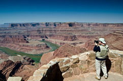 Taking a photo. Young man taking some pictures in Dead Horse Point State Park in Utah royalty free stock photos