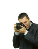 Taking a Photo. Man in a suit taking a photo Royalty Free Stock Image