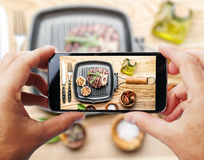 Taking photo of beef steak by smartphone. Stock Photo
