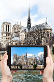 Taking photo of cathedral Notre-Dame de Paris Stock Photos