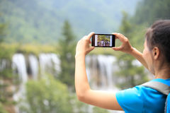 Taking photo with cell phone Stock Photography