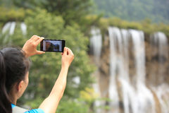 Taking photo with cell phone Stock Photo