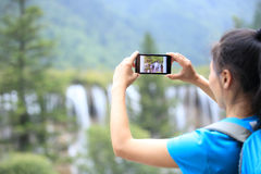Taking photo with cell phone Royalty Free Stock Images