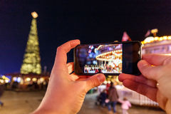 Taking photo of Christmas fair in Hyde park in 2016 Stock Photos