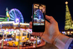 Taking photo of Christmas fair in Hyde park in 2016 Royalty Free Stock Photos