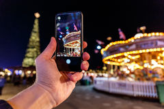 Taking photo of Christmas fair in Hyde park in 2016. London Stock Image