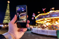 Taking photo of Christmas fair in Hyde park in 2016 Stock Image
