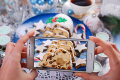 Taking a photo of christmas stollen cake by smartphone Stock Photos