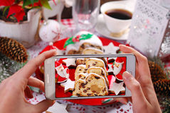 Taking a photo of christmas stollen cake by smartphone Stock Images