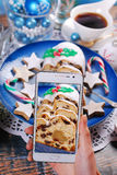 Taking a photo of christmas stollen cake by smartphone Stock Image