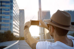 Taking a photo of city at sunset royalty free stock photos