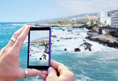 Taking a photo of the coast Royalty Free Stock Image