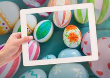 Taking photo of Easter eggs with smart phone Royalty Free Stock Photo