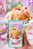 Taking photo of easter ring cake by smartphone Royalty Free Stock Images
