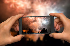 Taking photo of fireworks with mobile phone royalty free stock photo
