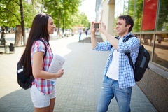 Taking photo of girlfriend Royalty Free Stock Photography
