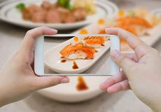 Taking photo of Grilled salmon sushi royalty free stock photo