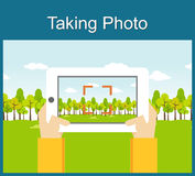 Taking photo illustration flat design. Taking photo by gadget concept. Stock Photos