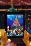 Taking photo with ipad 4. Taking photo of santa come with noahs ark with a black ipad 4 in the christmas of 2012 Stock Images