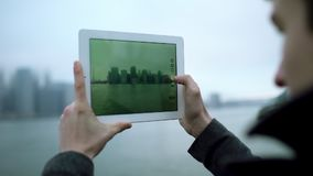 Taking a photo of Manhattan island on tablet pc camera stock video
