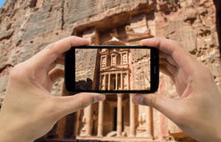 Taking photo on mobile of Petra Royalty Free Stock Images