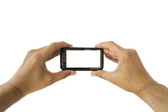 Taking photo on mobile phone concept in horizontal Stock Image