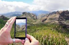 Taking a photo of mountains Royalty Free Stock Photo