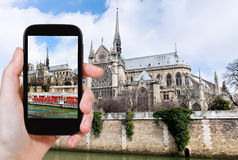 Taking photo of Notre Dame Paris and tourist boat Stock Photography