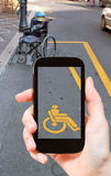 Taking photo of parking space for disabled people Stock Photo