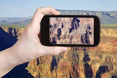 Taking photo of rocky mountains in Grand Canyon Stock Photos