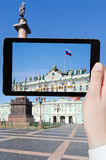 Taking photo Russian state flag on Palace Square. Travel concept - tourist taking photo of Russian state flag on Palace Square, St.Petersburg, Russia on mobile royalty free stock images