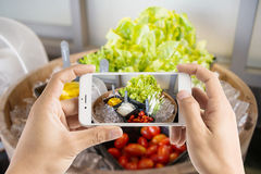 Taking photo of salad bar with vegetables in the restaurant. Stock Photography