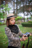 Taking a photo shot. Asian woman smiling look at the camera Royalty Free Stock Photography