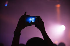 Taking photo on a smartphone camera Stock Images