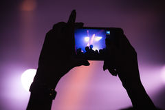 Taking photo on smartphone, night show Royalty Free Stock Images