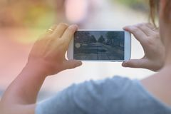 Taking photo with smartphone royalty free stock photos