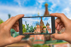 Taking photo of St. Basils cathedral in Moscow with cell phone Stock Photography