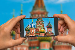 Taking photo of St. Basils cathedral in Moscow with cell phone Royalty Free Stock Image